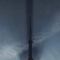 CN Tower throughs a long sahdow early morning