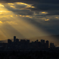 Vancouver in rays of evening sun as seen from Burnaby Centre