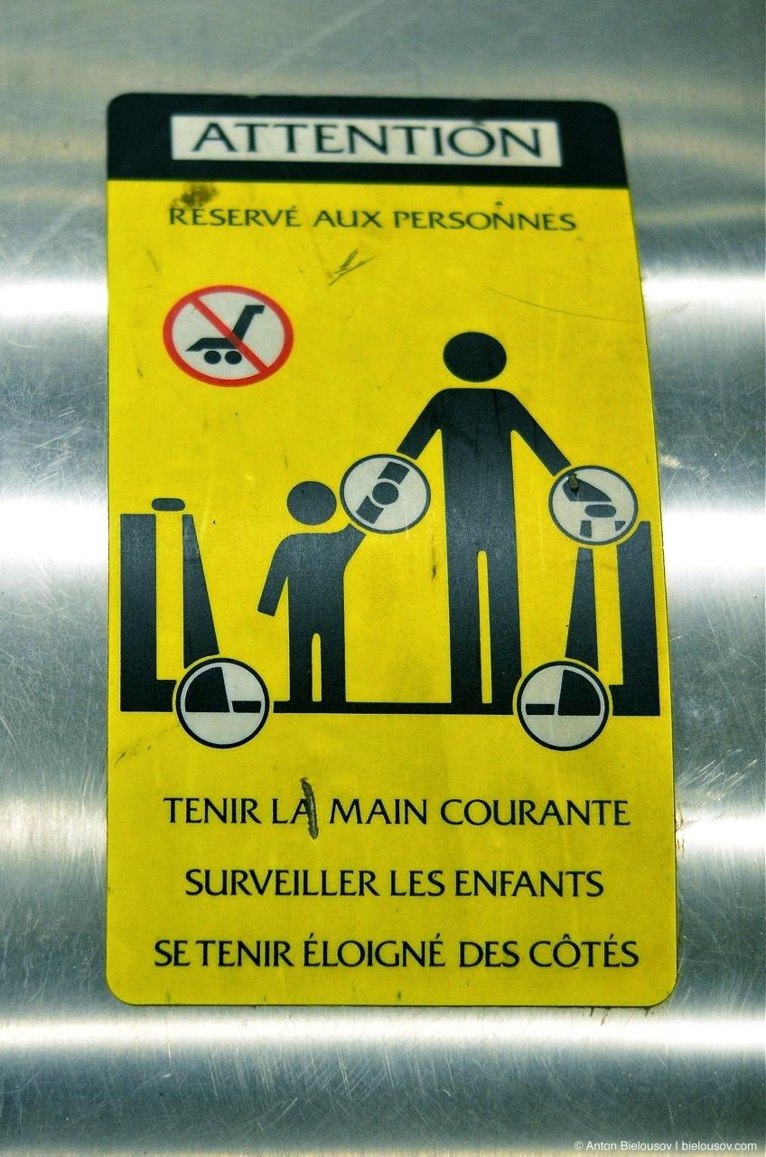 Montréal Metro Escalator warning sign