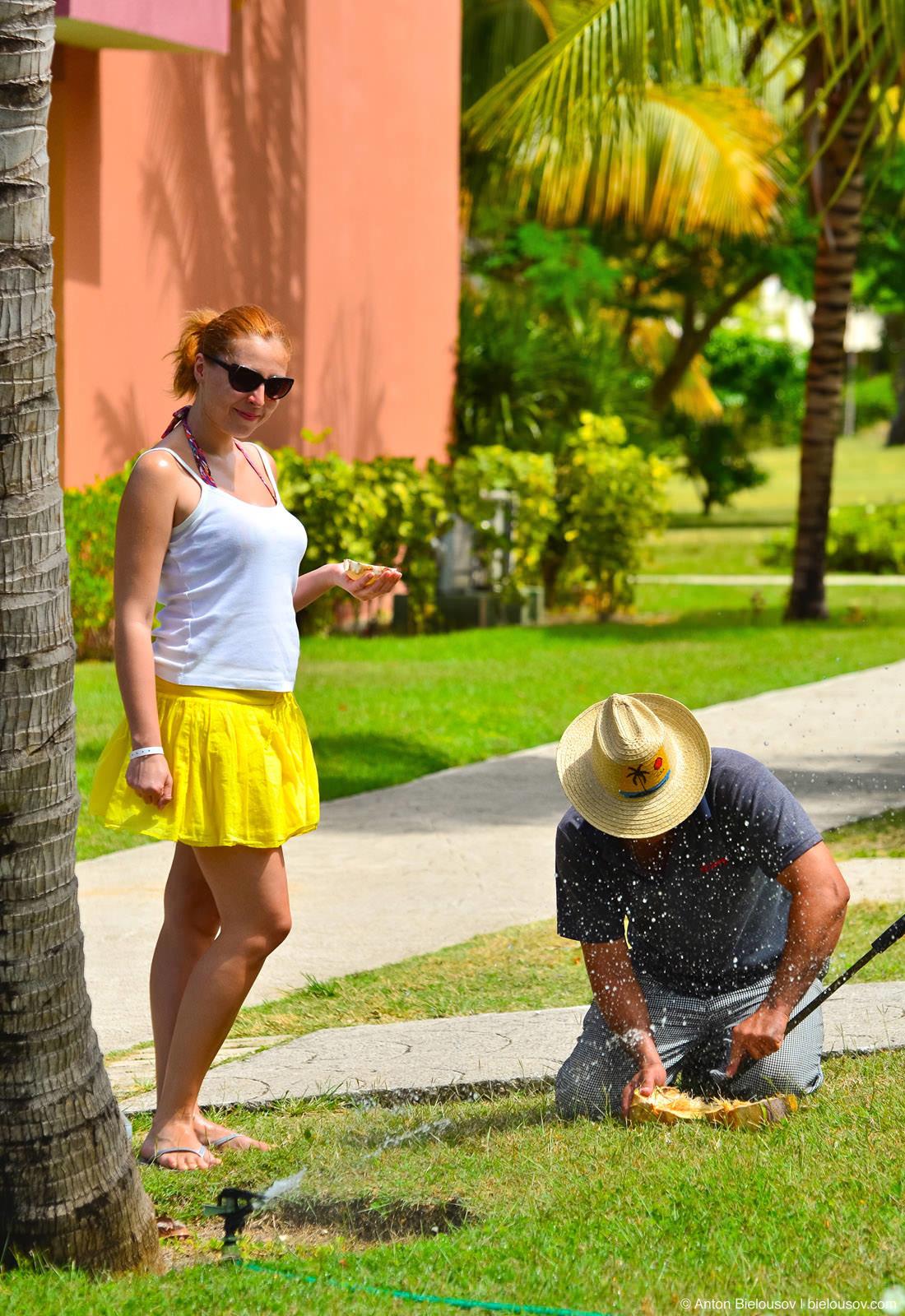 Cuban peels a coconut in Club Amigo Atlantico Guardalavaca hotel