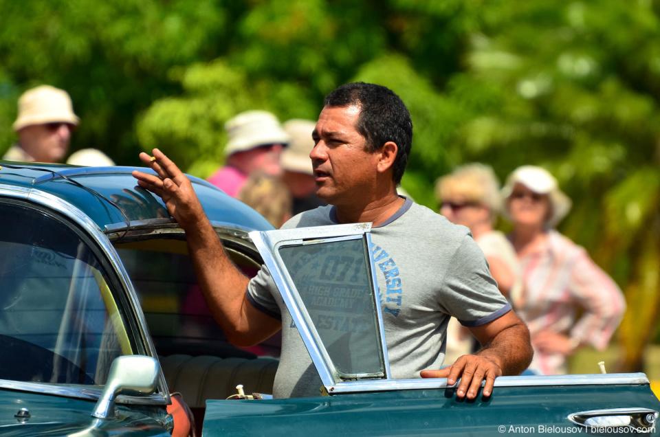 Cuban vintage taxi driver
