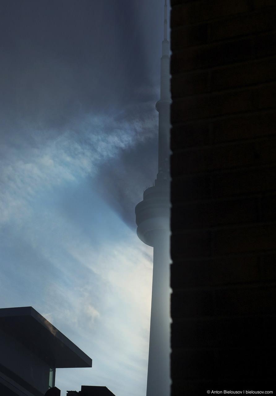 CN Tower throughs a long sahdow early morning