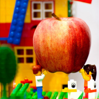Grapple apple in hands of Lego