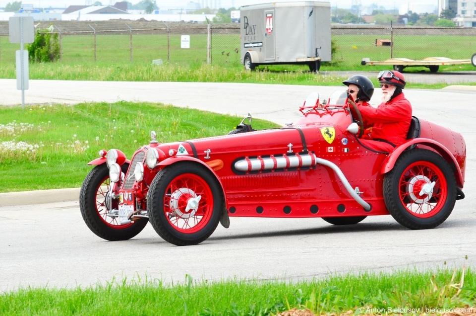 Santa Claus driving old Fiat (Ferrari)