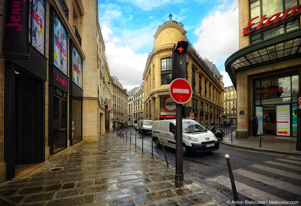 Paris One way road red plus sign streetlight
