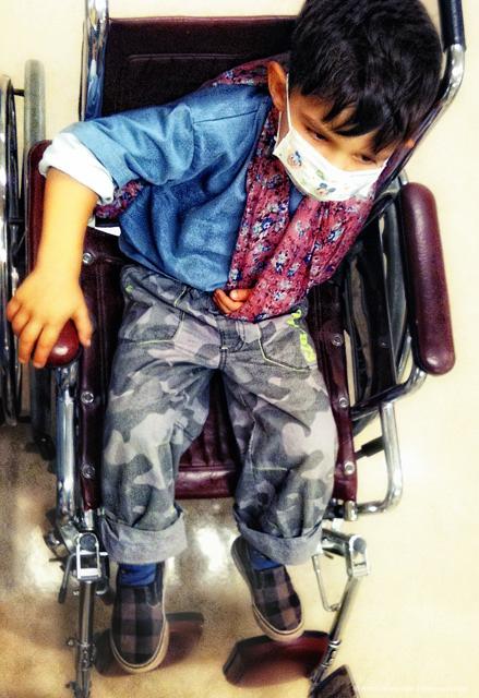 Tosha in a wheelchair