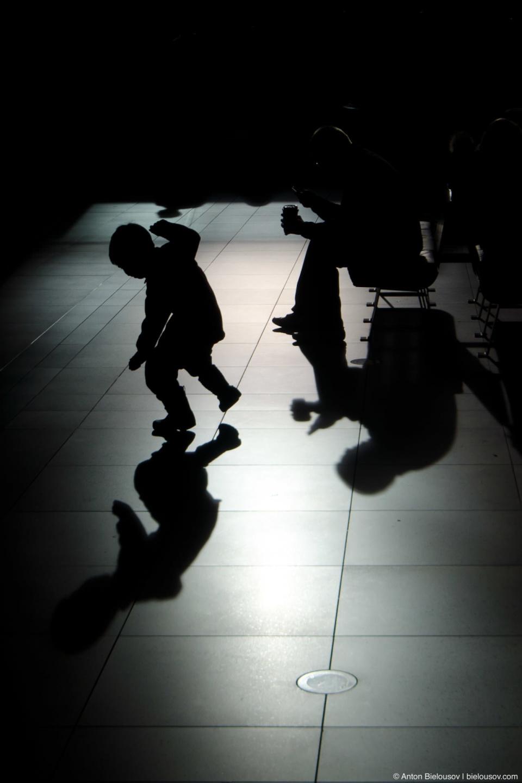 Dancing kid's shadow (Toronto Eaton's Centre)