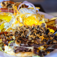 12oz burger eating challenge in Riverbed Bistro at Keremos, BC