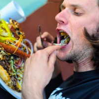 Yuriy Dybskiy participating in burger eating challenge at Riverbed Bistro in Keremos, BC