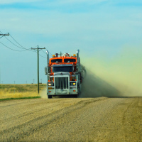 Truck in cloud of dust