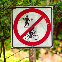 Skateboarding and biking prohibited sign in Minoru Park (Richmond, BC)