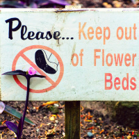 Please keep out of flowers beds sign (Queen Elizabeth park, Vancouver. BC)