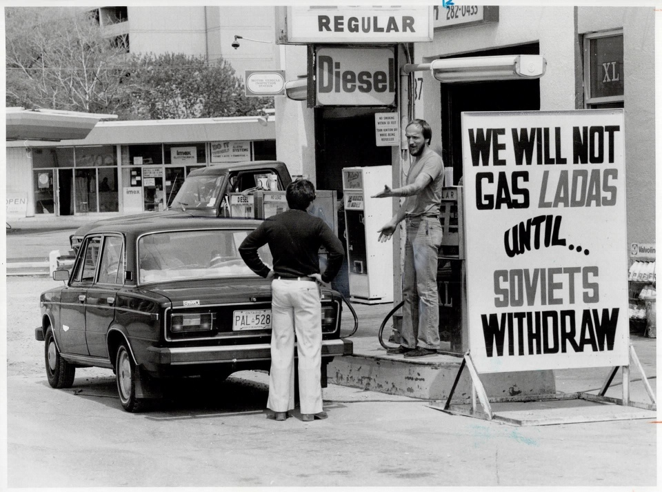 Courtesy of Toronto Public Library & the Toronto Star Archives. Photo credit Reg Innell -- Sign of the times: Star reporter Rick Brennan argues with gas station owner Neil Shepherd; who's refusing to gas Russian-made Lada cars -- 1980