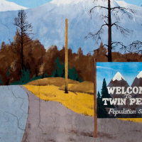 Twin Peaks welcome sign on Twede's Cafe mural art (North Bend, WA)